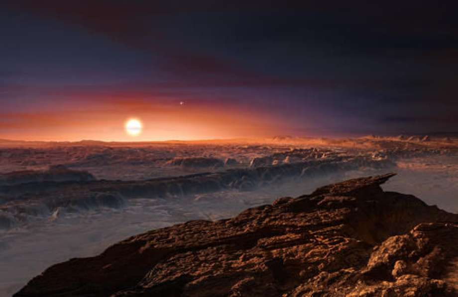 This artist rendering provided by the European Southern Observatory shows a view of the surface of the planet Proxima b orbiting the red dwarf star Proxima Centauri, the closest star to the Solar System. The double star Alpha Centauri AB also appears in the image to the upper-right of Proxima itself. Proxima b is a little more massive than the Earth and orbits in the habitable zone around Proxima Centauri, where the temperature is suitable for liquid water to exist on its surface. (European Southern Observatory via AP) Photo: HONS
