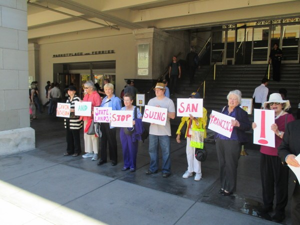 Protesters ask Newsom to call off the suit against SF