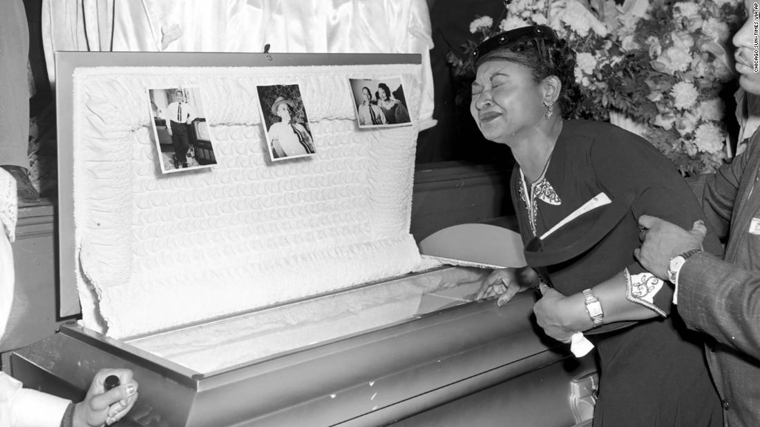 Mamie Till Mobley weeps at the funeral of her son, Emmett Till, on September 6, 1955, in Chicago. Two men were acquitted by an all-white jury of killing him.