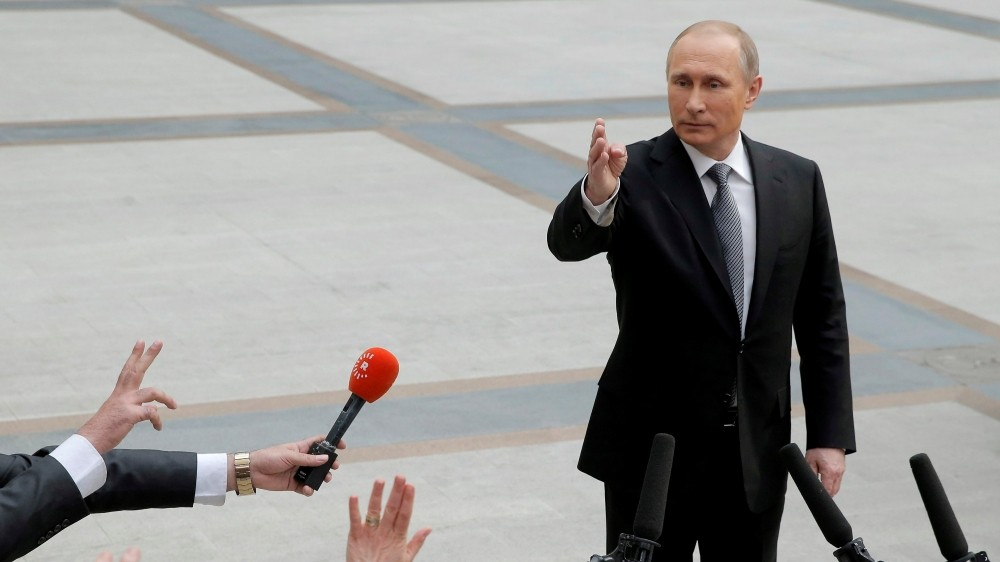 Russian President Vladimir Putin speaks with journalists after a live broadcast nationwide call-in, Moscow, April 14, 2016